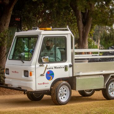 City of Santa Monica Public Works Employee Driving Small Truck in a Park