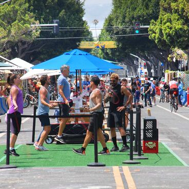 Exercise class, pedestrians and bikes on Main Street in Santa Monica