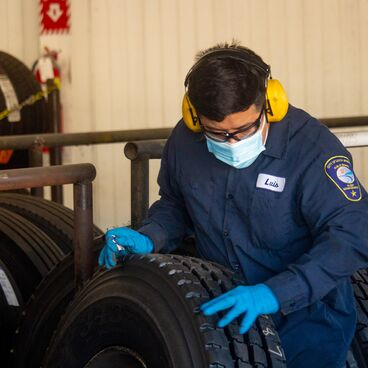 City of Santa Monica Public Works Employee Wearing a Mask and Checking a Tire